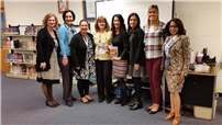 Author Regina Calcaterra pictured with Brookhaven Elementary School staff.